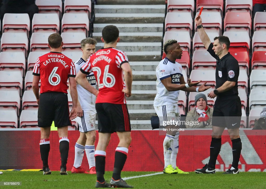 Adama Traore (R) of Middlesbrough is sent off during the Sky Bet Championship match between Sunderland and Middlesbrough at Stadium of Light on February 24, 2018 in Sunderland, England.