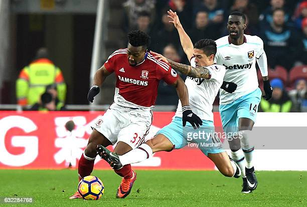 Adama Traore of Middlesbrough is tackled by Manuel Lanzini of West Ham United during the Premier League match between Middlesbrough and West Ham...