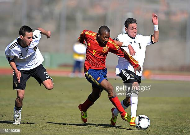 Adama Traore of Spain battles for the ball against Devante Parker and Jasin Ghandour of Germany during the U16 International friendly match between...