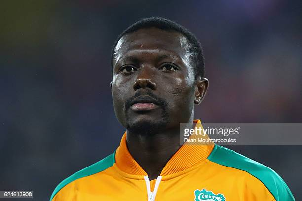 Adama Traore of The Ivory Coast stands for the national anthem prior to the International Friendly match between France and Ivory Coast held at Stade...