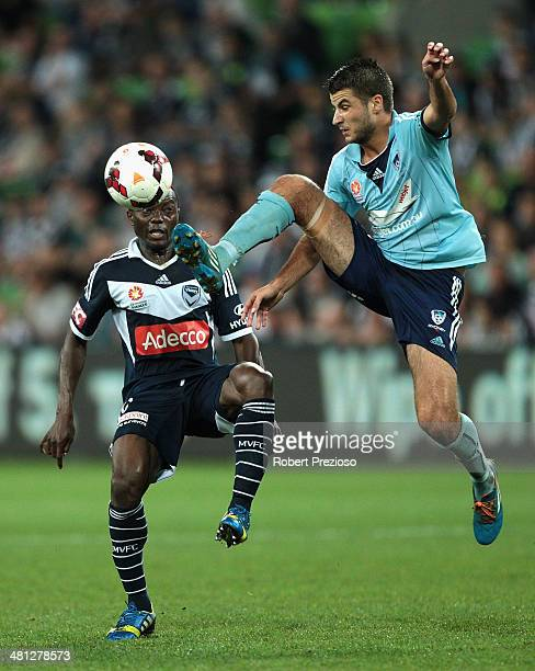 Adama Traore of the Victory and Terry Antonis of Sydney contest the ball during the round 25 ALeague match between Melbourne Victory and Sydney FC at...