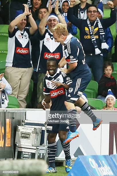 Adama Traore of the Victory is jumped on by Mitchell Nichols after scoring a goal during the round 10 ALeague match between the Melbourne Victory and...