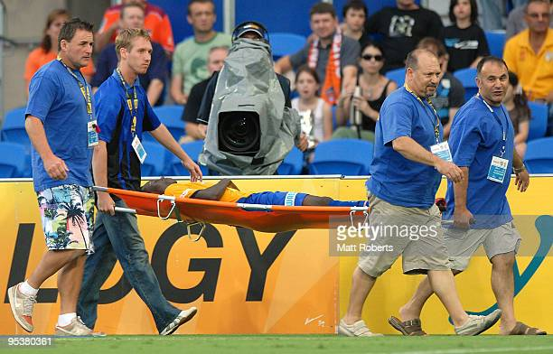 Adama Traore of United is carried off the field during the round 21 A-League match between Gold Coast United and Brisbane Roar at Skilled Park on...