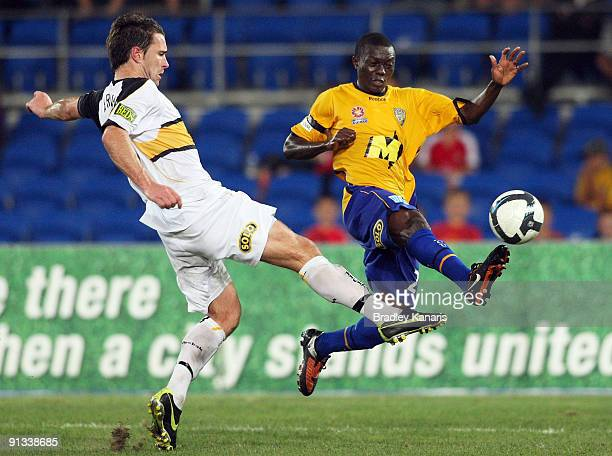 Adama Traore of United is tackled during the round nine A-League match between Gold Coast United and the Wellington Phoenix at Skilled Park on...