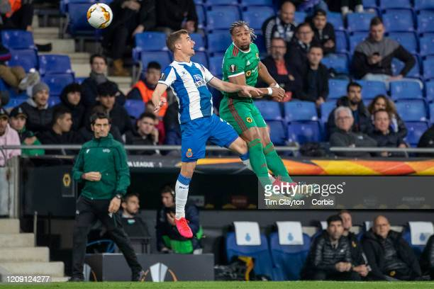 February 27: Adama Traore of Wolverhampton Wanderers and Adria Pedrosa of Espanyol challenge for the ball during the Espanyol V Wolverhampton...
