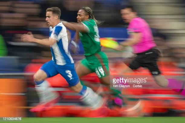 February 27: Adama Traore of Wolverhampton Wanderers and Adria Pedrosa of Espanyol chase for the ball as the linesman attempts to keep up during the...