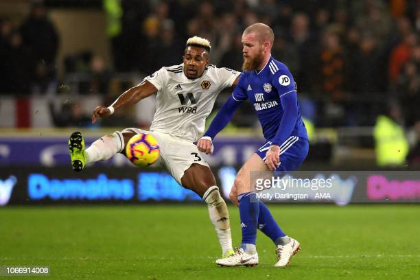Adama Traore of Wolverhampton Wanderers and Aron Gunnarsson of Cardiff City during the Premier League match between Cardiff City and Wolverhampton...