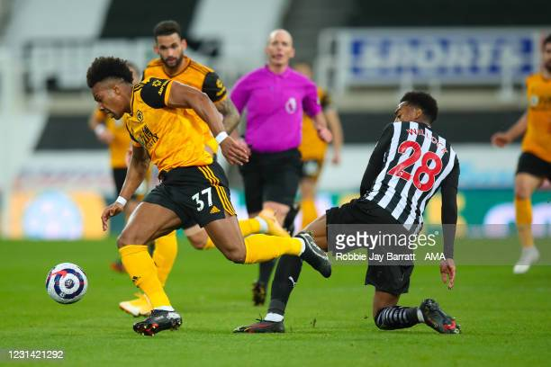 Adama Traore of Wolverhampton Wanderers and Joe Willock of Newcastle United during the Premier League match between Newcastle United and...