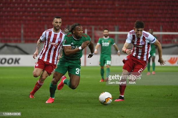 Adama Traore of Wolverhampton Wanderers and Kostas Tsimikas of Olympiacos FC during the UEFA Europa League round of 16 first leg match between...