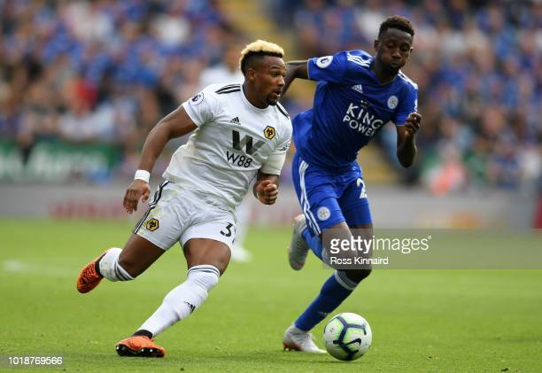 Adama Traore of Wolverhampton Wanderers and Onyinye Wilfred Ndidi of Leicester City battle for the ball during the Premier League match between...