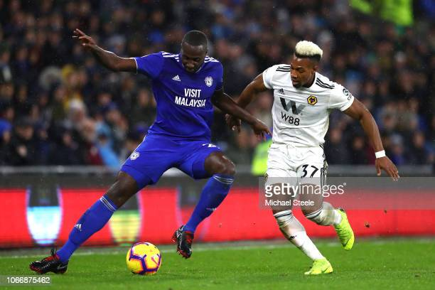 Adama Traore of Wolverhampton Wanderers and Sol Bamba of Cardiff City in action during the Premier League match between Cardiff City and...