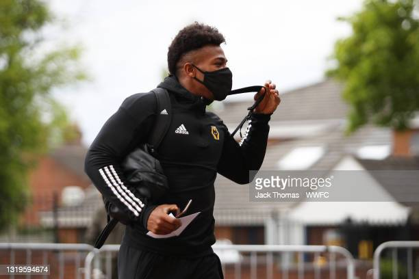 Adama Traore of Wolverhampton Wanderers arrives at the stadium to board the team bus to the hotel ahead of the Premier League match between...