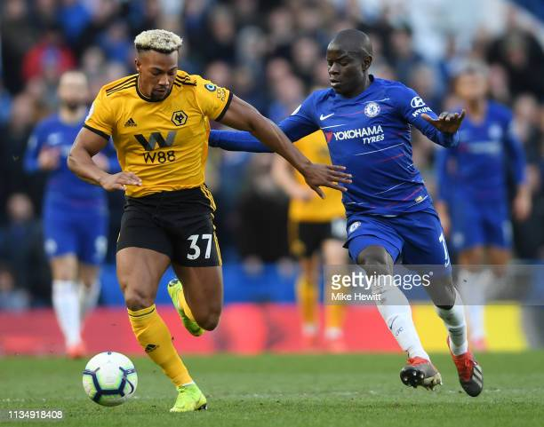 Adama Traore of Wolverhampton Wanderers battles for possession with N'golo Kante of Chelsea during the Premier League match between Chelsea FC and...