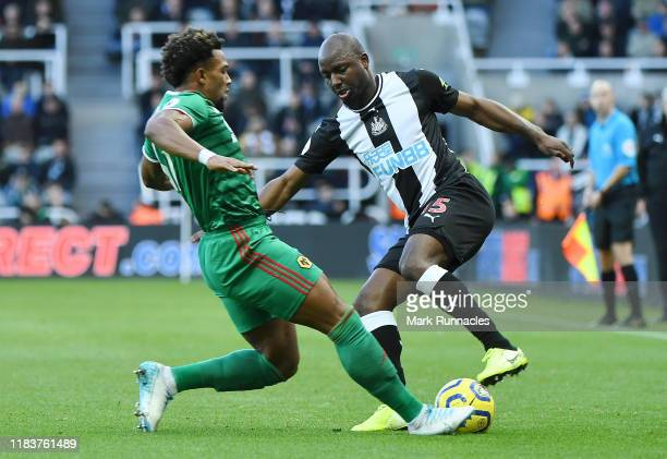 Adama Traore of Wolverhampton Wanderers battles for possession with Jetro Willems of Newcastle United during the Premier League match between...