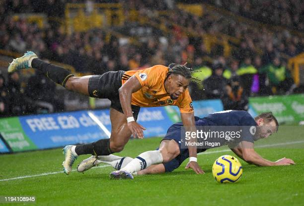 Adama Traore of Wolverhampton Wanderers battles for possession with Harry Kane of Tottenham Hotspur during the Premier League match between...