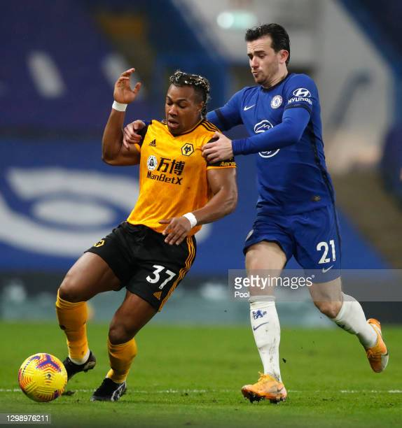 Adama Traore of Wolverhampton Wanderers battles for possession with Ben Chilwell of Chelsea during the Premier League match between Chelsea and...