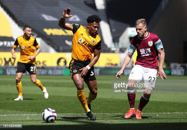 Adama Traore of Wolverhampton Wanderers battles for possession with Matej Vydra of Burnley during the Premier League match between Wolverhampton...