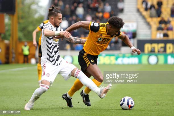 Adama Traore of Wolverhampton Wanderers battles for possession with Alex Telles of Manchester United during the Premier League match between...