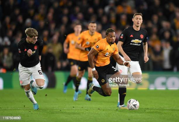 Adama Traore of Wolverhampton Wanderers breaks away from Brandon Williams and Nemanja Matic of Manchester United during the FA Cup Third Round match...