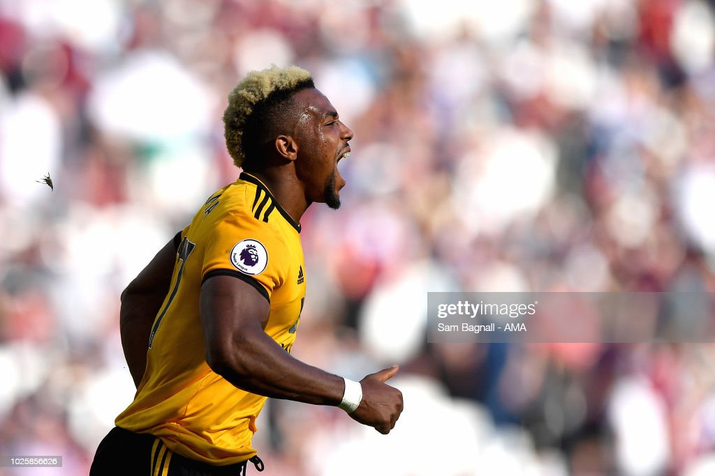 Adama Traore of Wolverhampton Wanderers celebrates after scoring a goal to make it 0-1 during the Premier League match between West Ham United and Wolverhampton Wanderers at London Stadium on September 1, 2018 in London, United Kingdom.