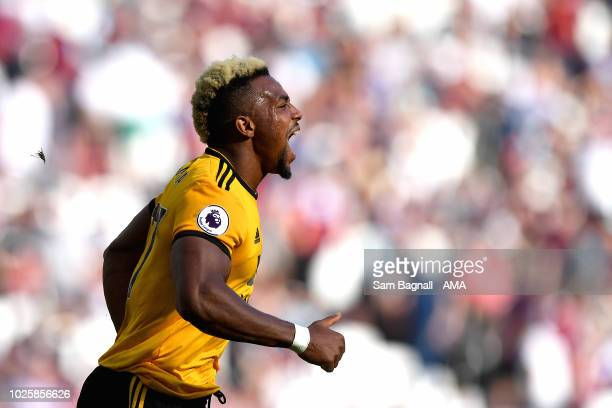 Adama Traore of Wolverhampton Wanderers celebrates after scoring a goal to make it 01 during the Premier League match between West Ham United and...