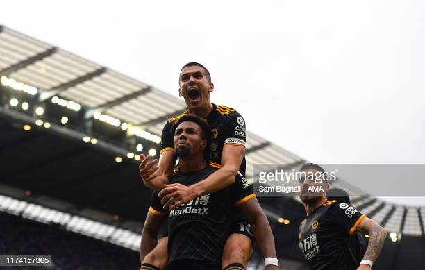 Adama Traore of Wolverhampton Wanderers celebrates after scoring a goal to make it 01 during the Premier League match between Manchester City and...