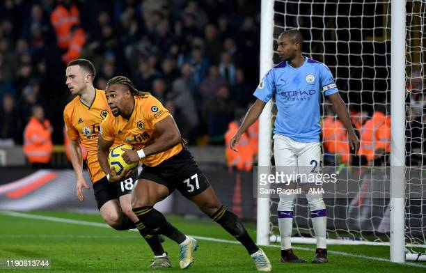 Adama Traore of Wolverhampton Wanderers celebrates after scoring a goal to make it 12 during the Premier League match between Wolverhampton Wanderers...
