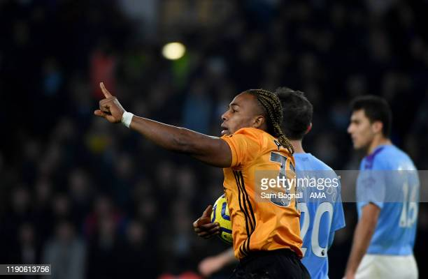 Adama Traore of Wolverhampton Wanderers celebrates after scoring a goal to make it 1-2 during the Premier League match between Wolverhampton...