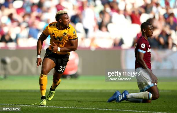 Adama Traore of Wolverhampton Wanderers celebrates after scoring his team's first goal during the Premier League match between West Ham United and...