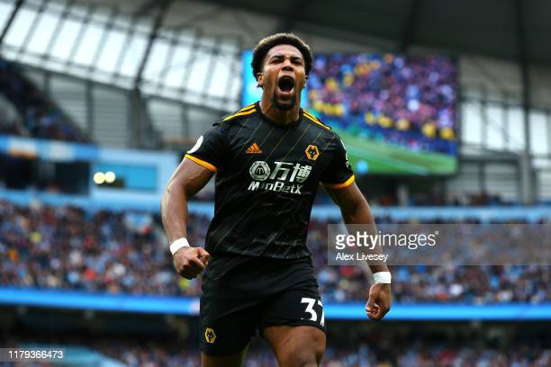 Adama Traore of Wolverhampton Wanderers celebrates after scoring his team's first goal during the Premier League match between Manchester City and...