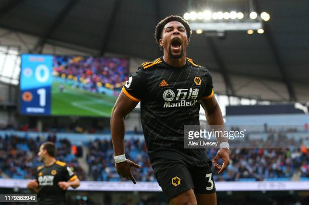 Adama Traore of Wolverhampton Wanderers celebrates after scoring his team's second goal during the Premier League match between Manchester City and...