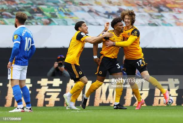Adama Traore of Wolverhampton Wanderers celebrates after scoring their sides first goal with team mates Fabio Silva and Morgan Gibbs-White during the...