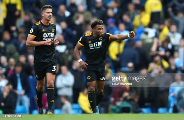 Adama Traore of Wolverhampton Wanderers celebrates scoring his teams second goal during the Premier League match between Manchester City and...