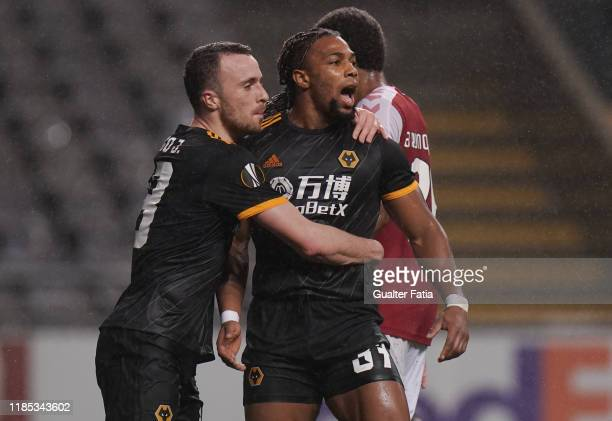 Adama Traore of Wolverhampton Wanderers celebrates with teammate Diogo Jota of Wolverhampton Wanderers after scoring a goal during the Group K UEFA...