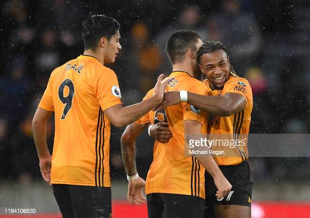 Adama Traore of Wolverhampton Wanderers celebrates with teammates after scoring his team's first goal during the Premier League match between...