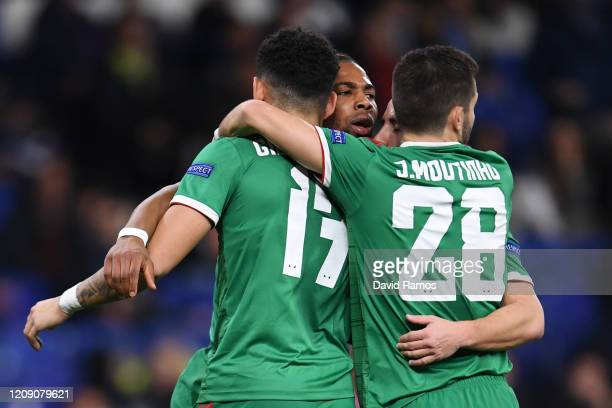 Adama Traore of Wolverhampton Wanderers celebrates with teammates after scoring his teams first goal during the UEFA Europa League round of 32 second...