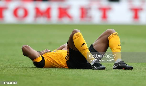 Adama Traore of Wolverhampton Wanderers goes down injured during the Premier League match between Wolverhampton Wanderers and Manchester United at...