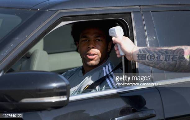 Adama Traore of Wolverhampton Wanderers has his temperature checked upon arriving at Sir Jack Hayward Training Ground on May 28 2020 in Wolverhampton...