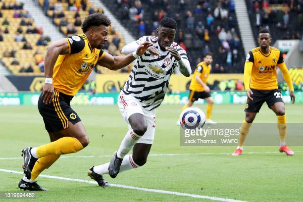 Adama Traore of Wolverhampton Wanderers is challenged by Axel Tuanzebe of Manchester United during the Premier League match between Wolverhampton...