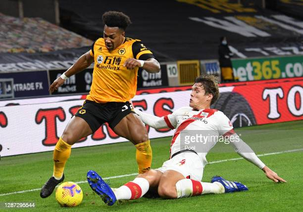 Adama Traore of Wolverhampton Wanderers is challenged by Jannik Vestergaard of Southampton during the Premier League match between Wolverhampton...