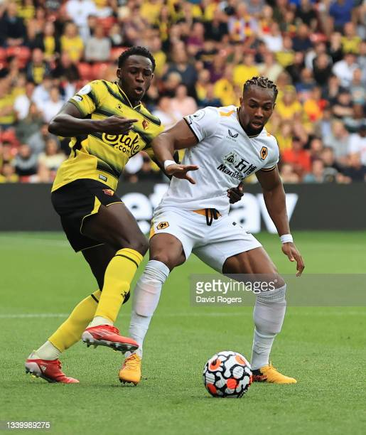 Adama Traore of Wolverhampton Wanderers is challenged by Jeremy Nkagia during the Premier League match between Watford and Wolverhampton Wanderers at...
