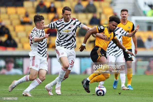 Adama Traore of Wolverhampton Wanderers is challenged by Nemanja Matic and Daniel James of Manchester United during the Premier League match between...