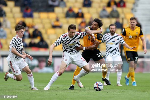 Adama Traore of Wolverhampton Wanderers is challenged by Nemanja Matic of Manchester United during the Premier League match between Wolverhampton...