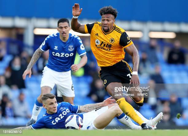 Adama Traore of Wolverhampton Wanderers is challenged by with Lucas Digne of Everton during the Premier League match between Everton and...