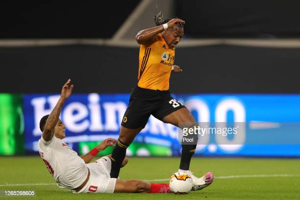 Adama Traore of Wolverhampton Wanderers is fouled by Diego Carlos of Sevilla resulting in a penalty during the UEFA Europa League Quarter Final...