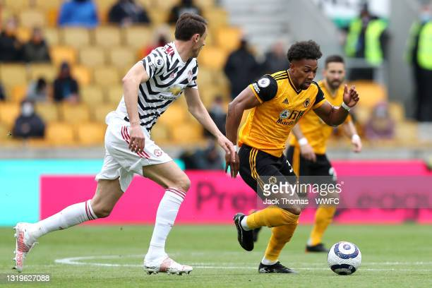 Adama Traore of Wolverhampton Wanderers is put under pressure by Nemanja Matic of Manchester United during the Premier League match between...