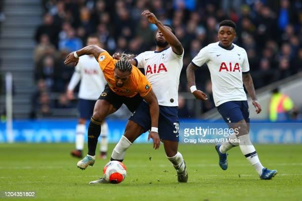 Adama Traore of Wolverhampton Wanderers is tackled by Japhet Tanganga of Tottenham Hotspur during the Premier League match between Tottenham Hotspur...