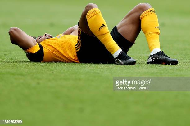 Adama Traore of Wolverhampton Wanderers lies on the pitch after he sustains an injury during the Premier League match between Wolverhampton Wanderers...