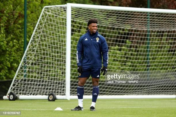 Adama Traore of Wolverhampton Wanderers looks on during a Wolverhampton Wanderers Training Session at Sir Jack Hayward Training Ground on May 21,...