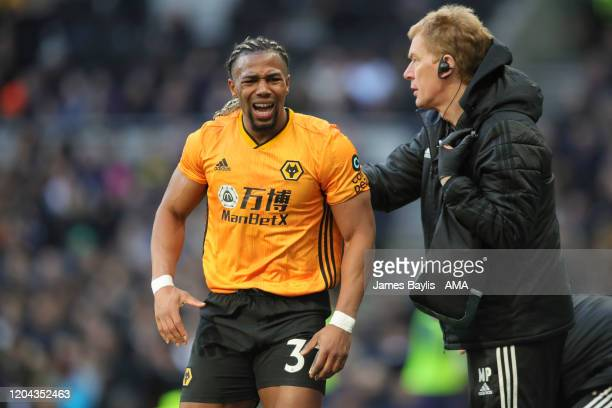 Adama Traore of Wolverhampton Wanderers receives treatment for a shoulder injury during the Premier League match between Tottenham Hotspur and...